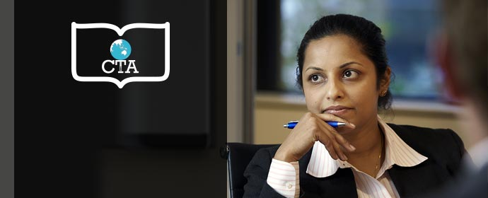 A lady listening in a office meeting room environment